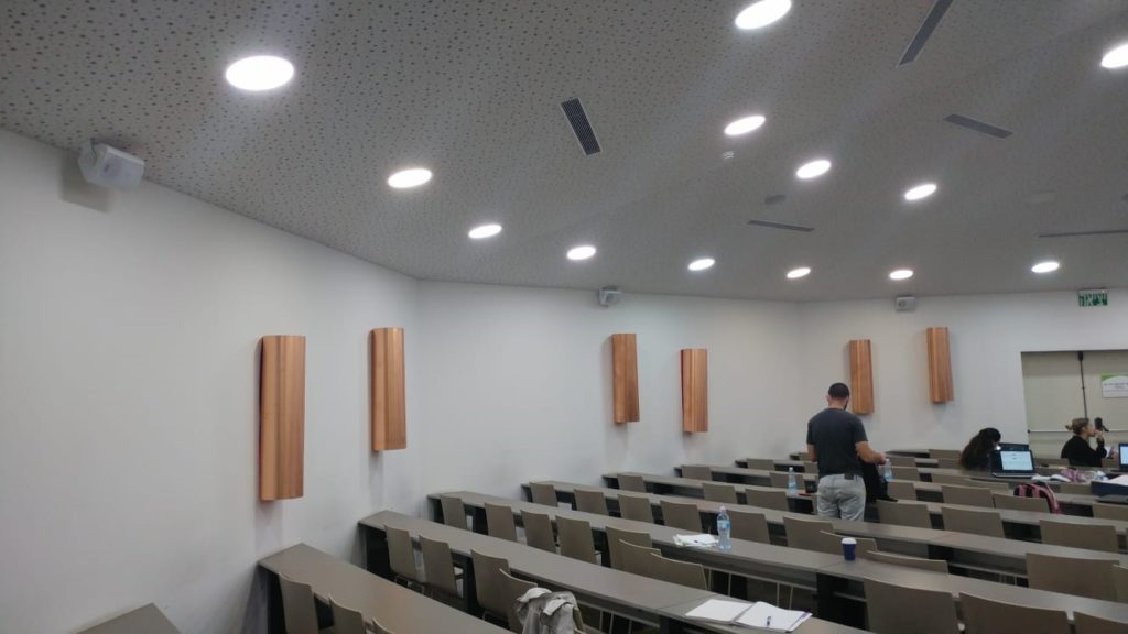 Surround speakers mounted on the wall in lecture theatre