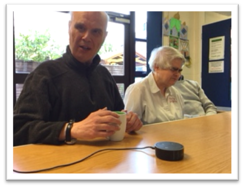 David and Anne use an Echo Dot to choose music in their Book Club session