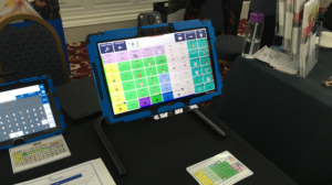 A table with tablet AAC devices