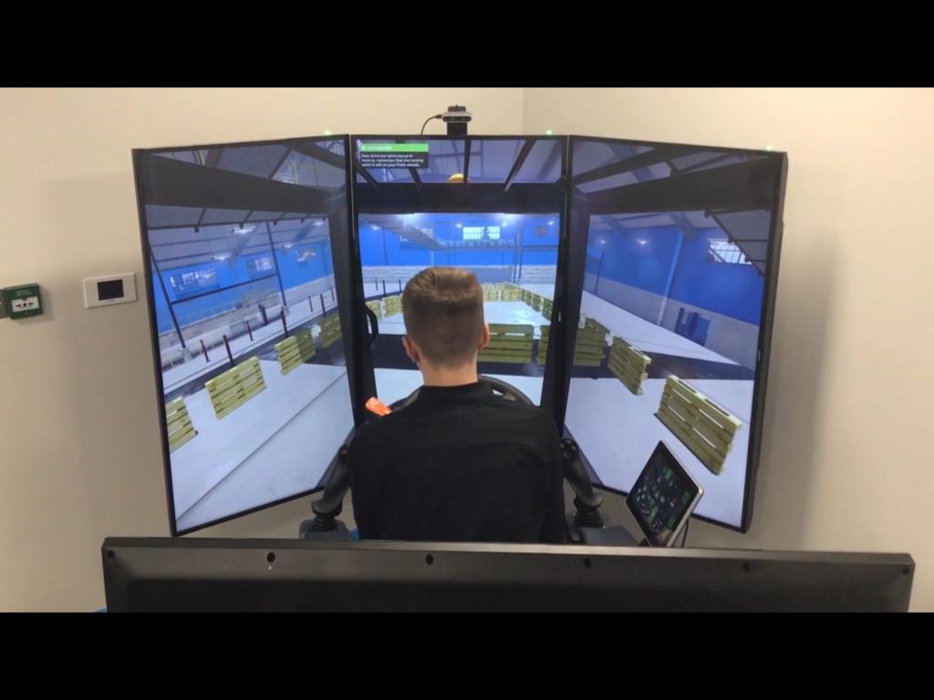 Learner driving a VR forklift