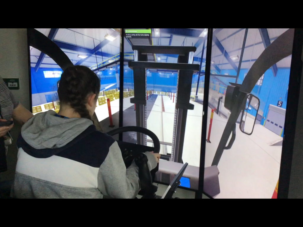Learner being taught how to operate a VR forklift