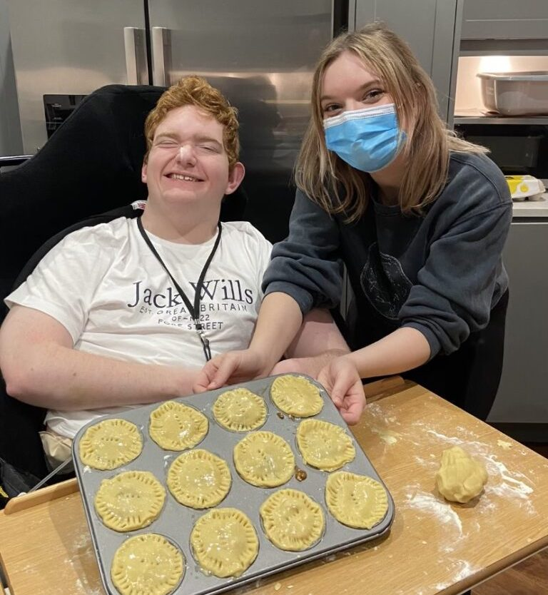 Nicholas's carer, Mary in the kitchen together baking pies