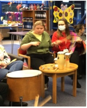 students in College and at home during a live Zoom drumming workshop