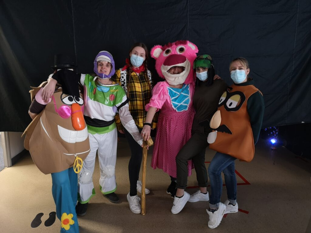 People from On Track dressed in Toy Story costumes