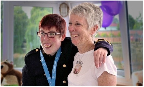 Jess (left) is isolating at home with mum Jo (right) and leads her own sign language group online