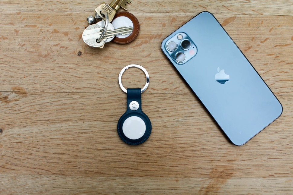 Apple's AirTag next to an iPhone