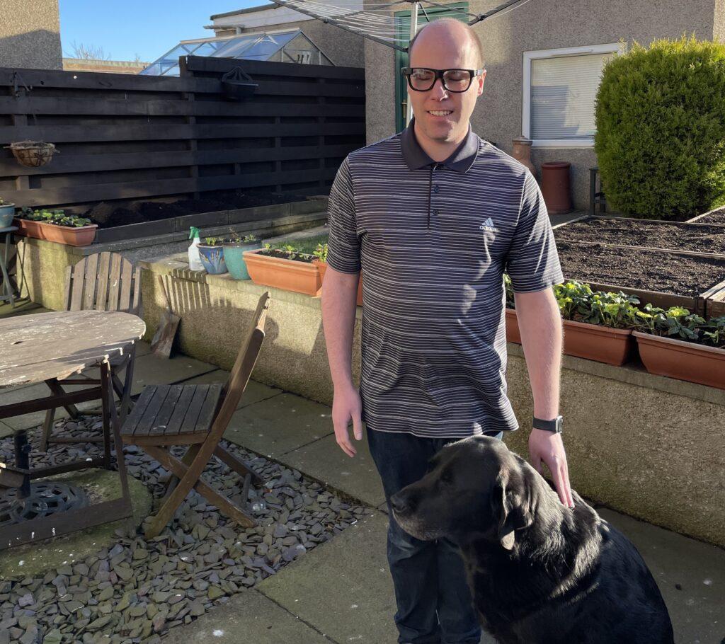 Stuart Beveridge with his guide dog