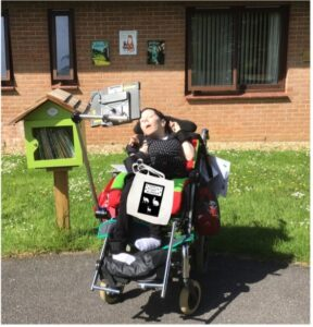 A student in a wheelchair who works at Treloar Enterprise Printing Solutions
